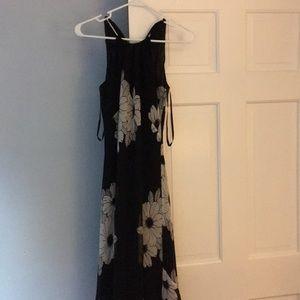 Knee length black floral dress.